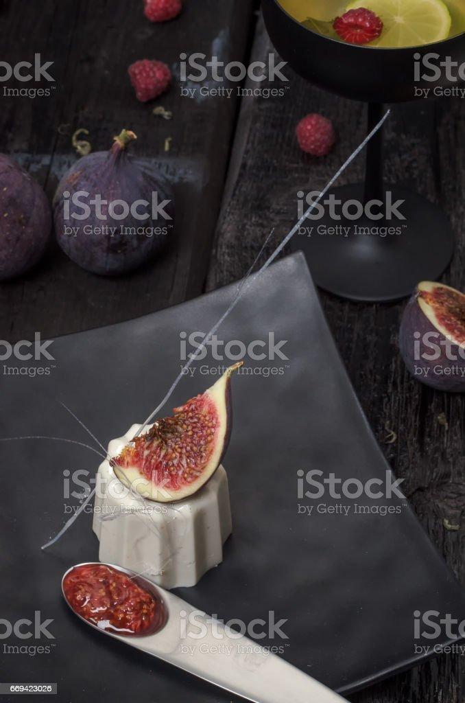 Italian dessert panna cotta with figs stock photo