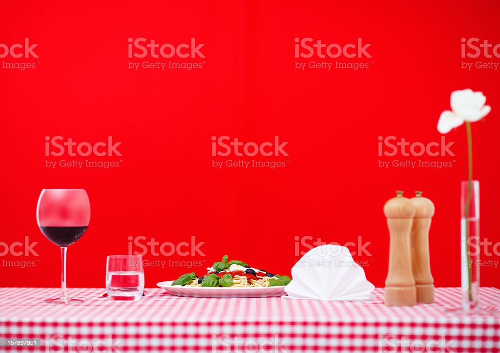 Italian dining table with spaghetti and wine royalty-free stock photo