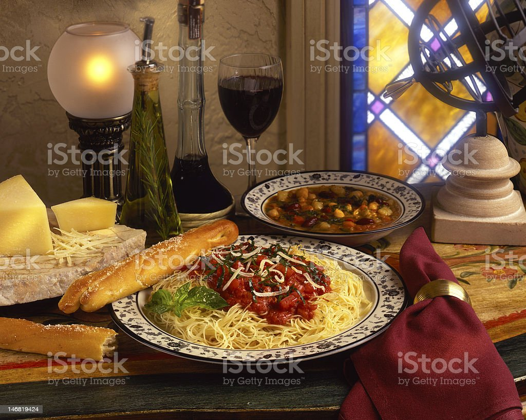 Italian dinner with spaghetti and minestrone soup stock photo