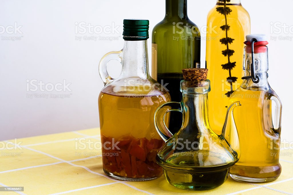 Italian dressing bottles on a table royalty-free stock photo