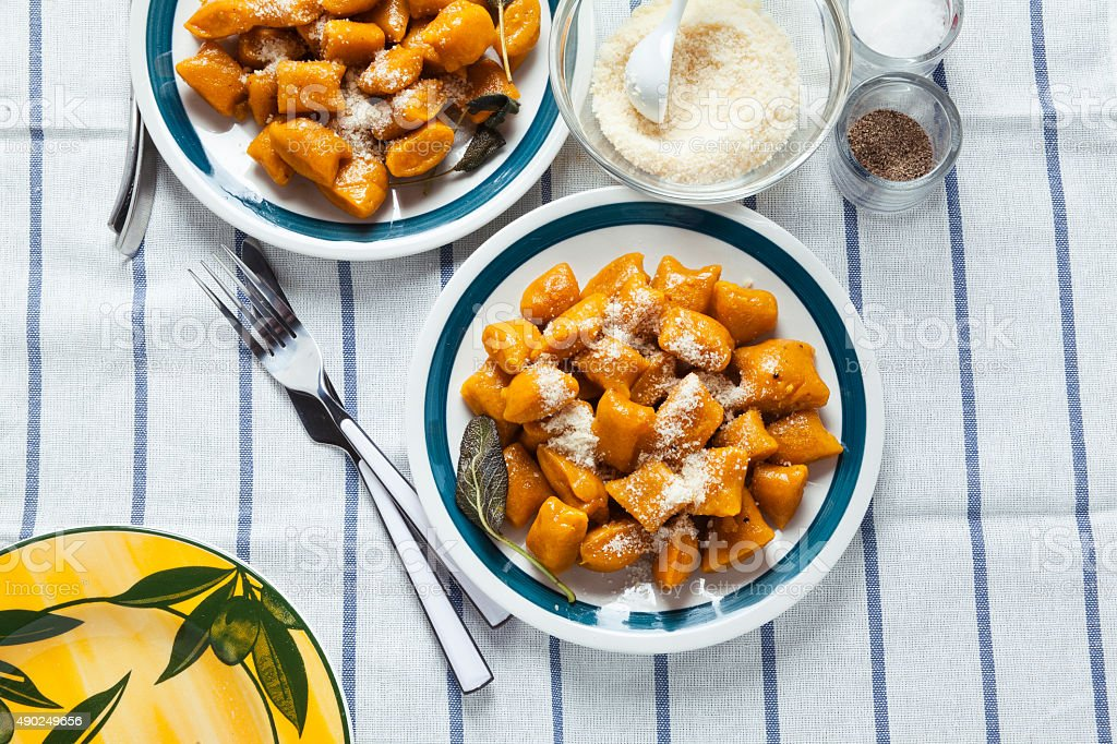Italian dumplings. pumpkin gnocchi. healthy vegetarian squash stock photo