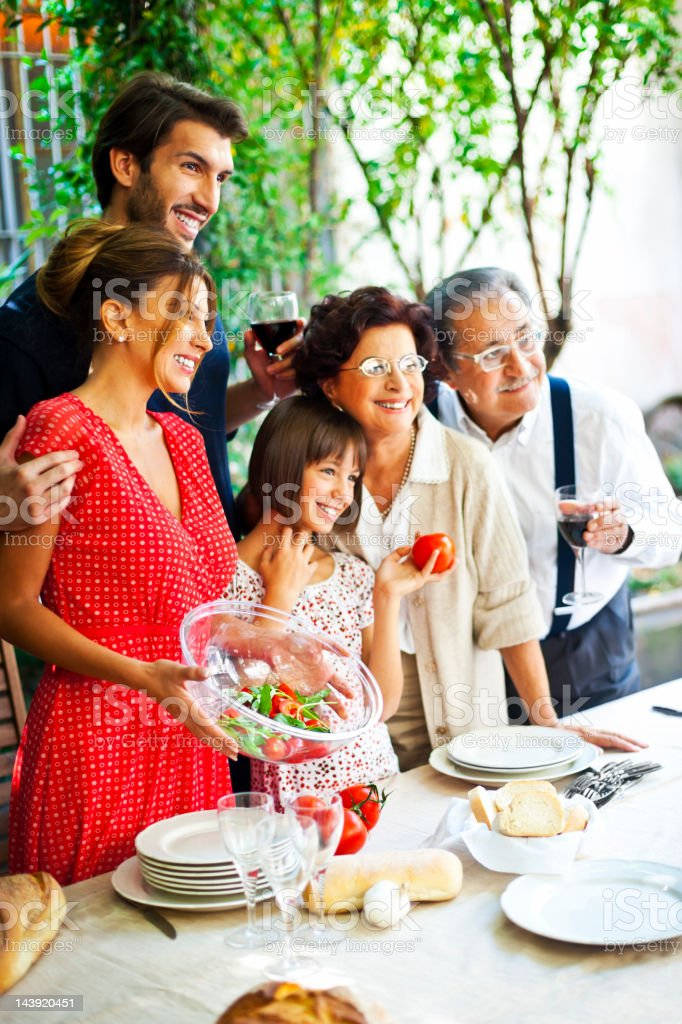 Italian family setting table stock photo
