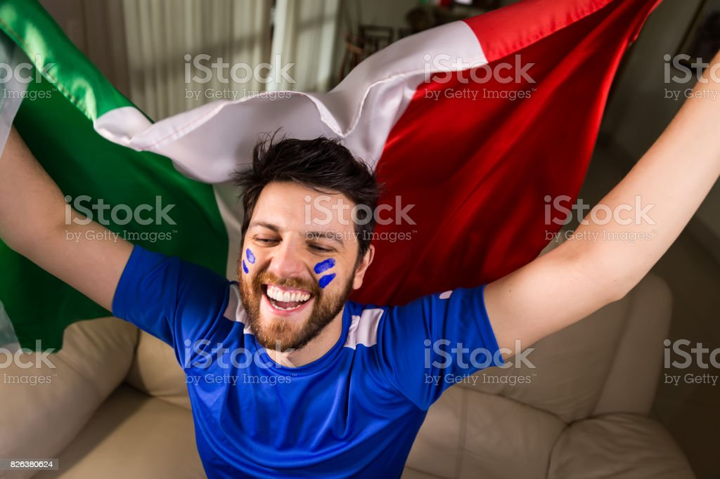 Italian fan holding the national flag stock photo