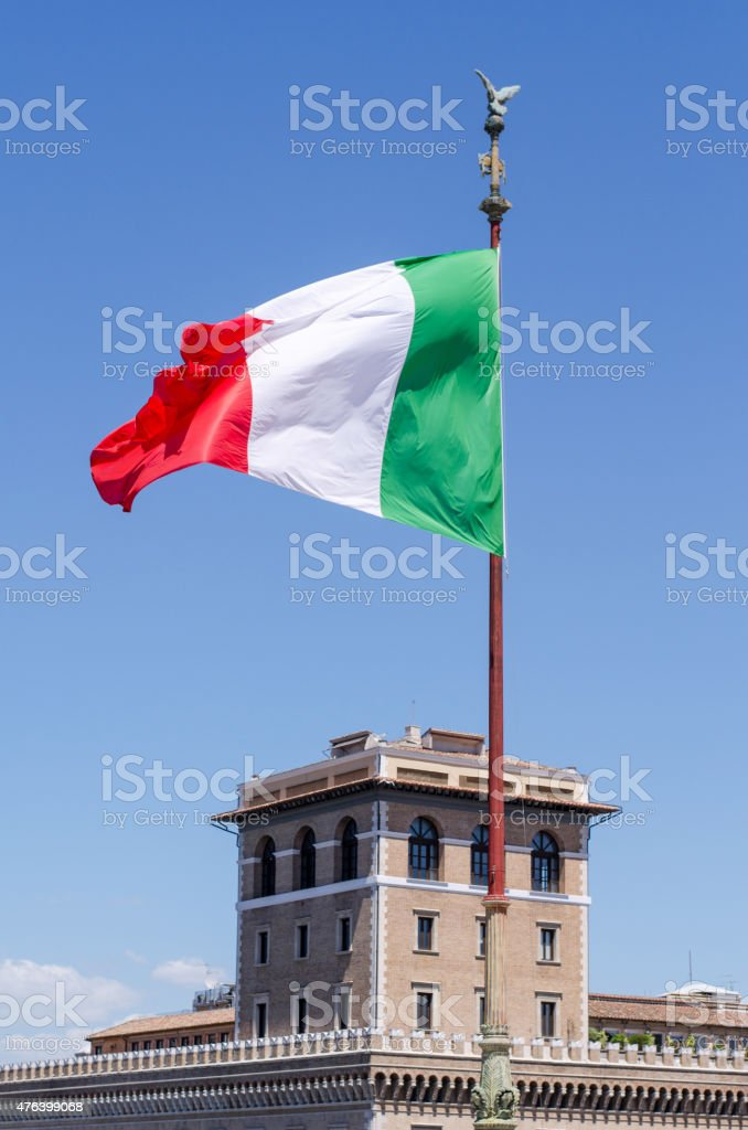 Italian flag blowing in the wind. stock photo