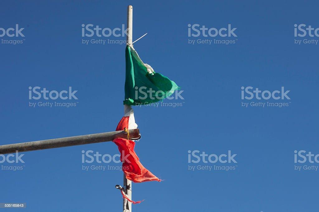 Italian flag destroyed stock photo