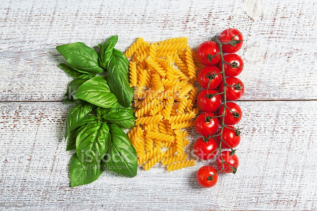 italian flag from basil pasta and tomatoes stock photo