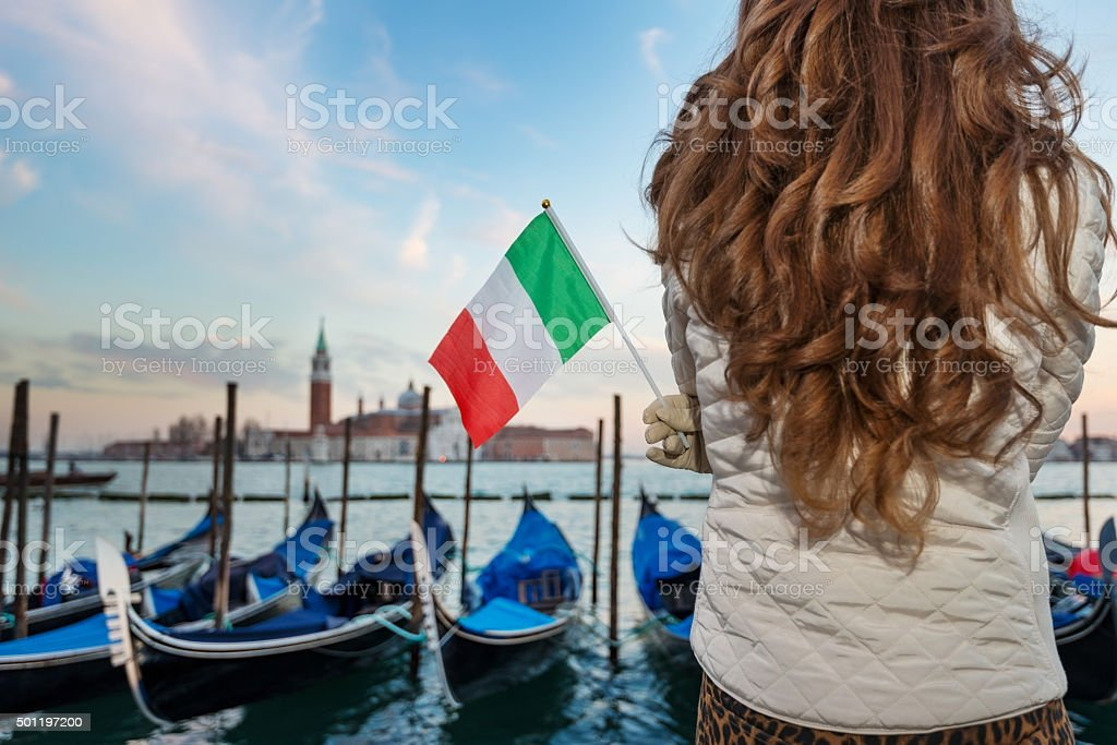 Italian flag in hands of woman, Venice. Closeup stock photo