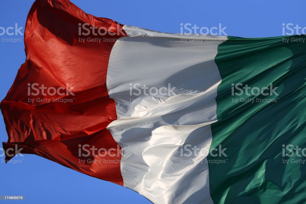 Italian flag in the wind stock photo
