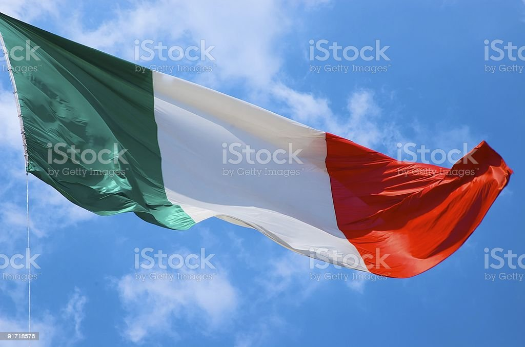 Italian flag on a blue sky royalty-free stock photo