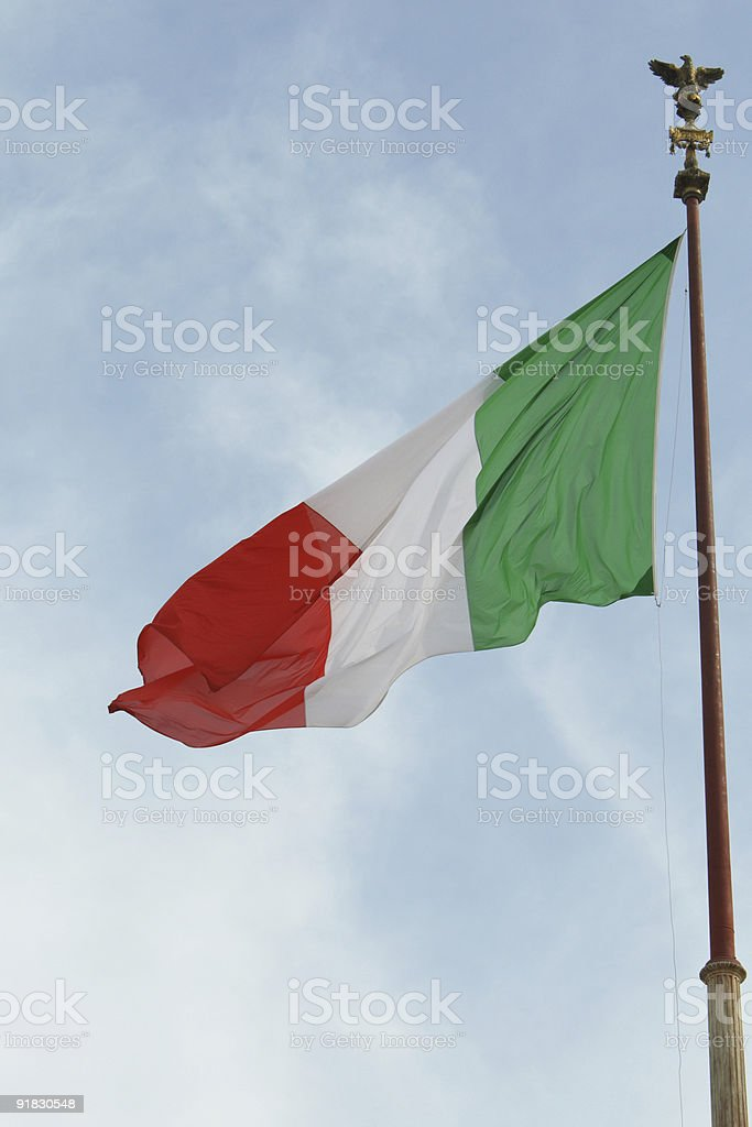 Italian flag on background of blue sky royalty-free stock photo