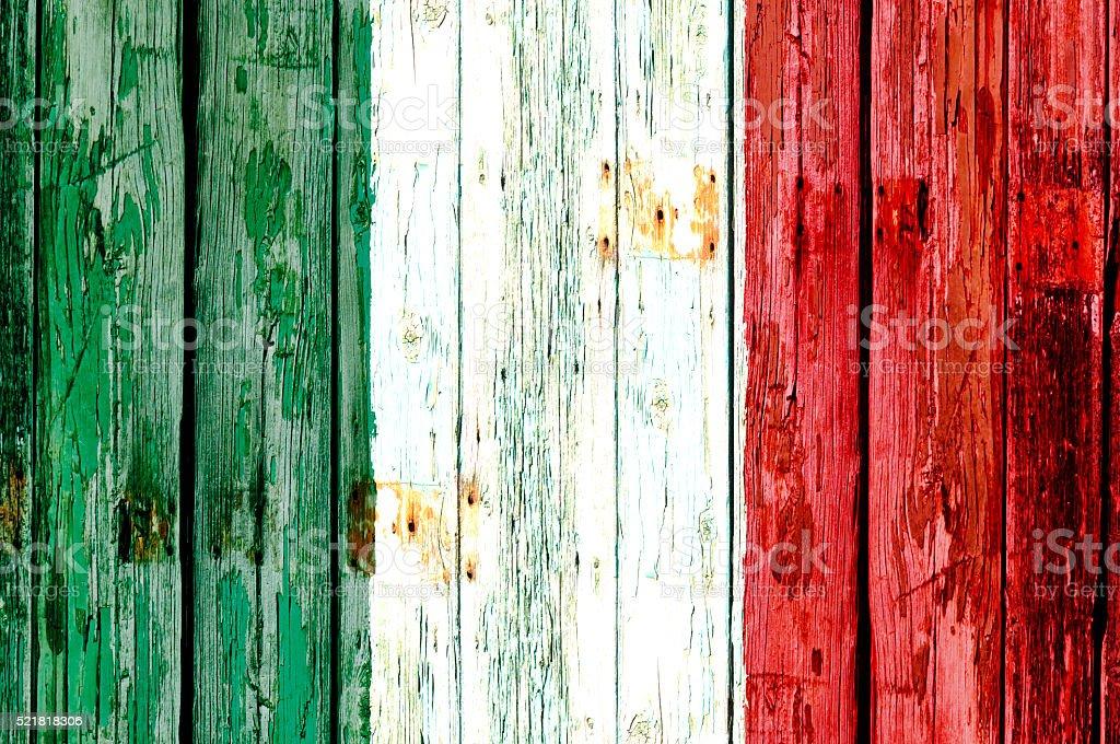 Italian flag on old wooden door stock photo