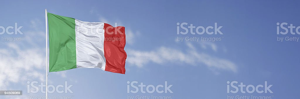 Italian flag over blue sky royalty-free stock photo