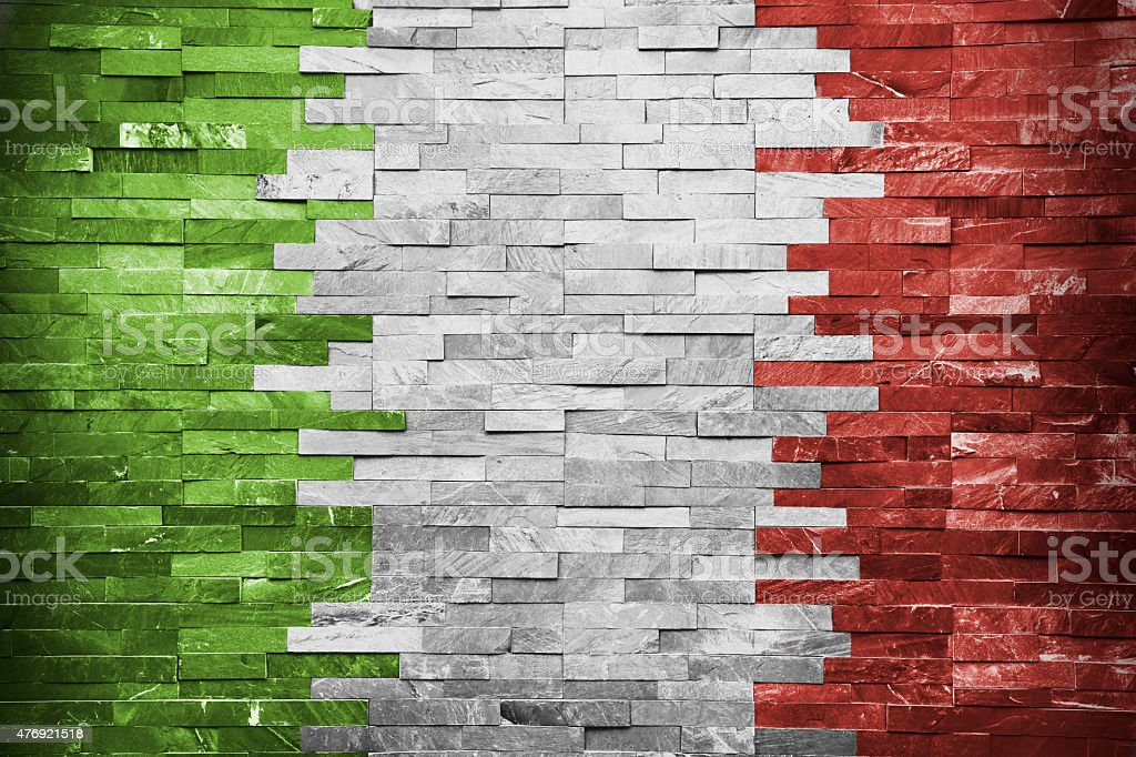 Italian Flag painted in a brick wall stock photo