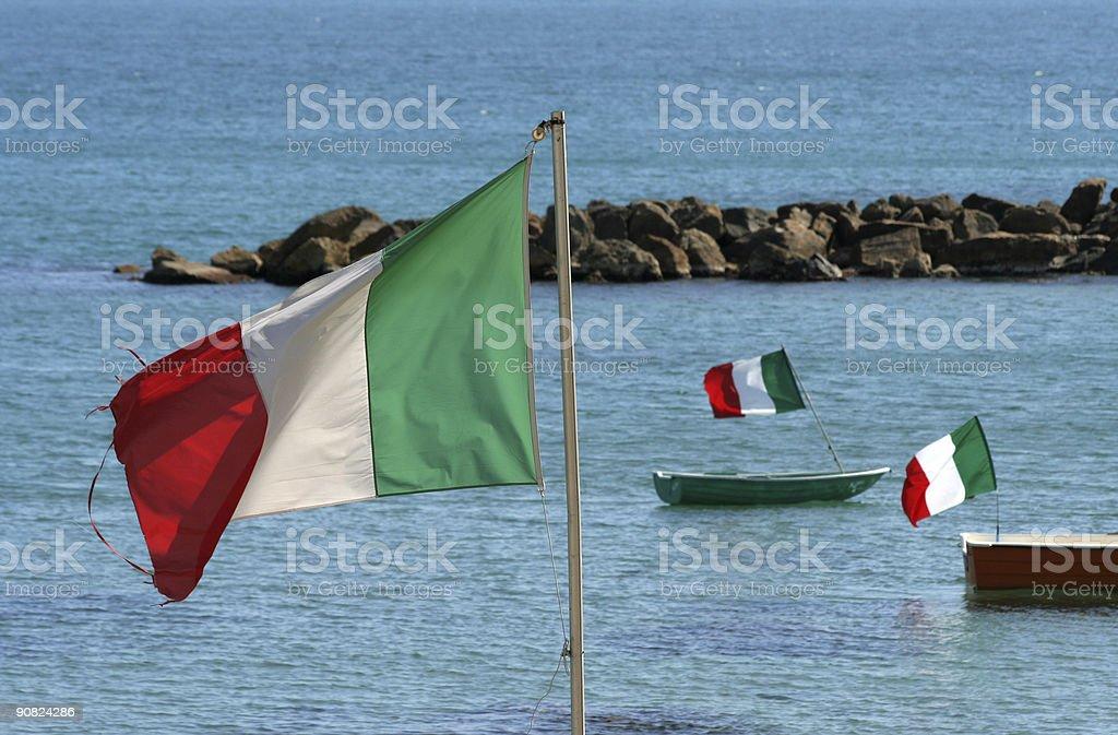 Italian flags at the beach royalty-free stock photo