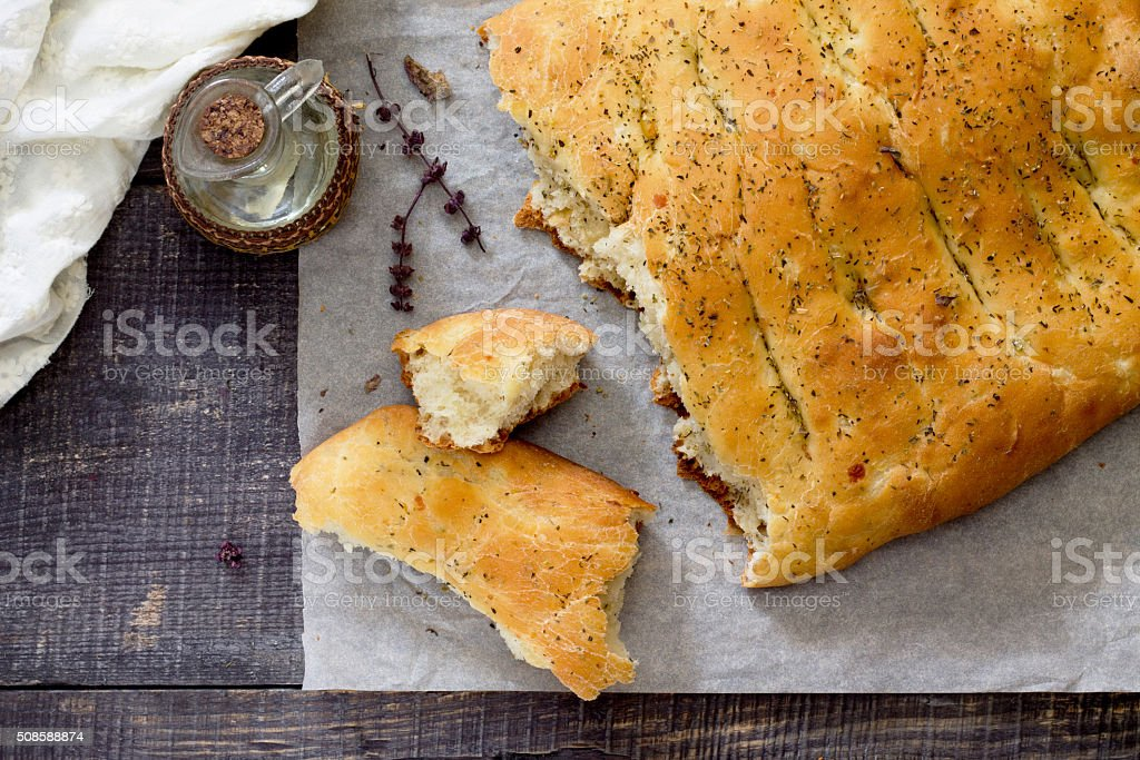 Italian focaccia bread with cheese and onions, top view. stock photo