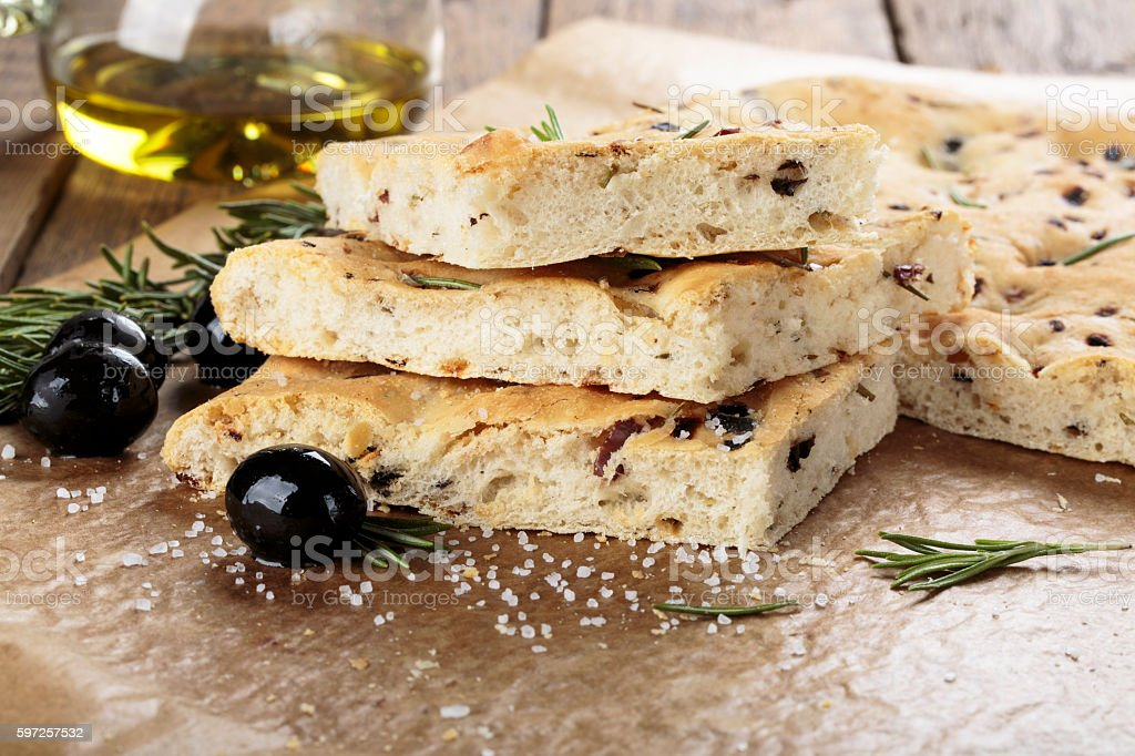 Italian focaccia bread with olives and rosemary. stock photo