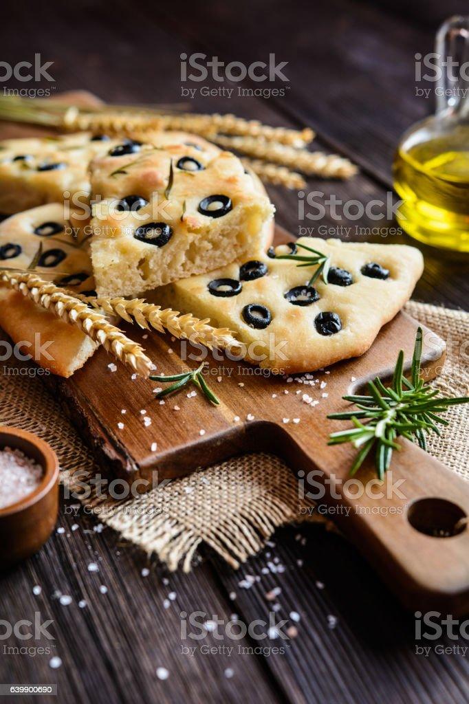 Italian Focaccia with olives and rosemary stock photo