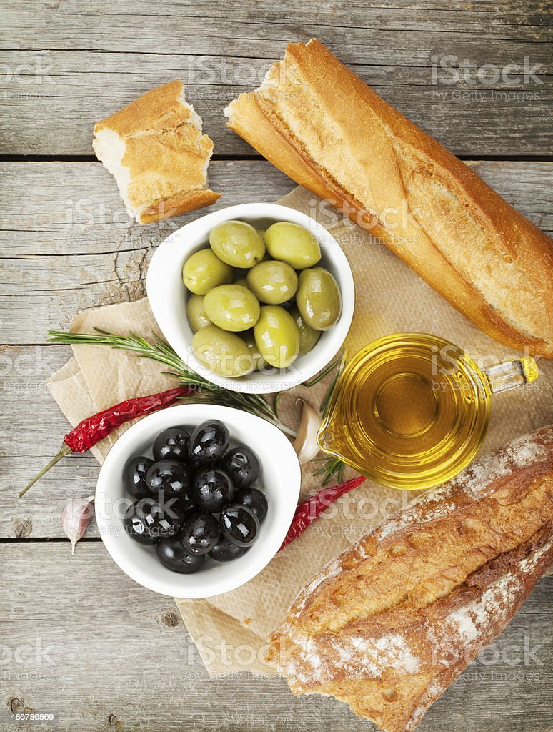 Italian food appetizer of olives, bread and spices stock photo