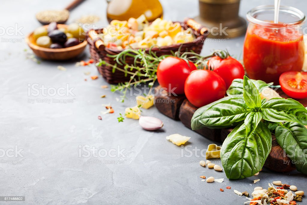 Italian food background Ingredients on stone table Copy space stock photo