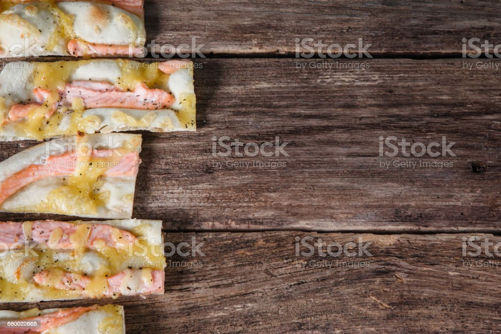 Italian food background. Slices of pizza on table. stock photo