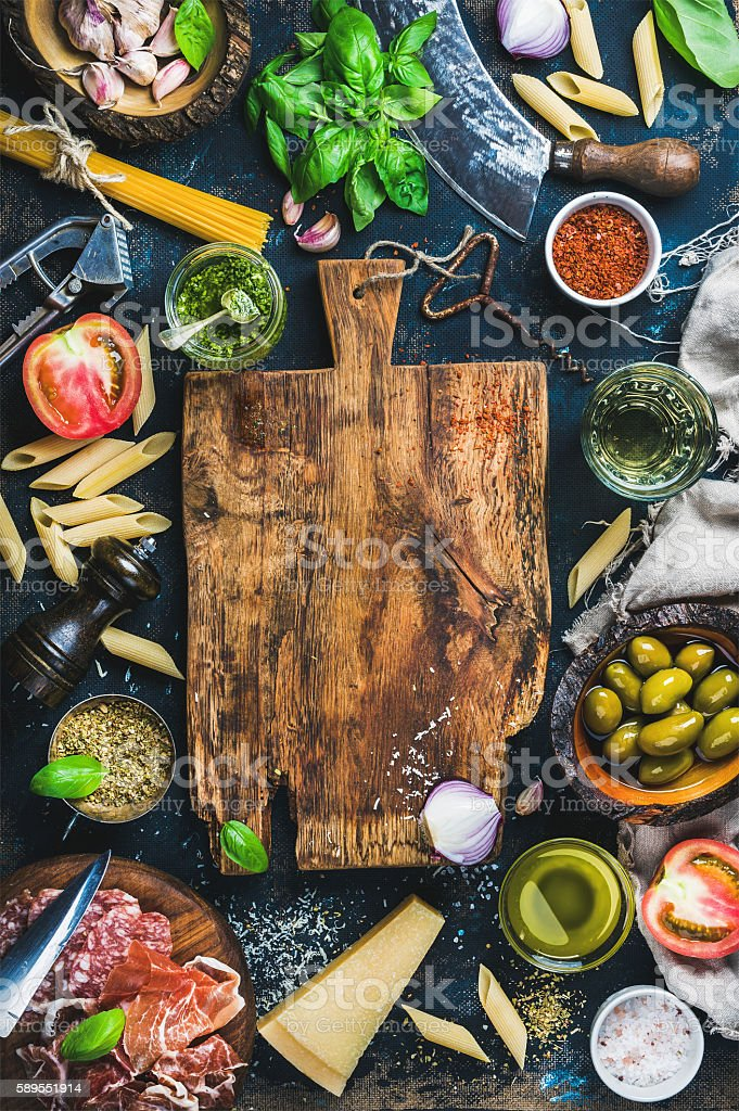 Italian food cooking ingredients on dark background stock photo