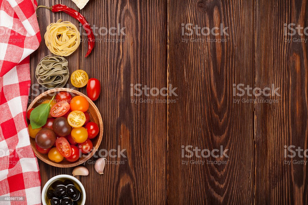 Italian food cooking ingredients. Pasta, vegetables, spices stock photo
