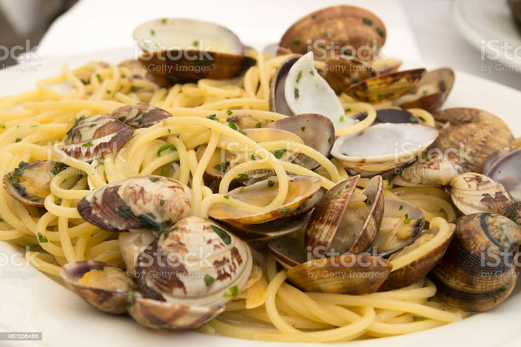 Italian food. Delicious spaghetti with clams . stock photo