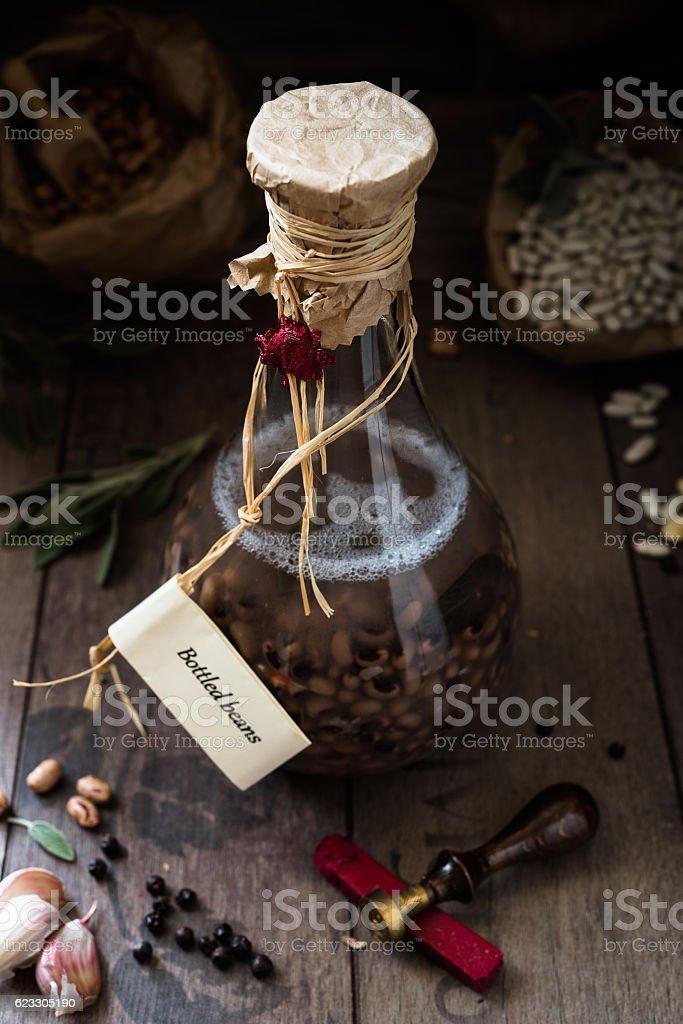 Italian food: eye beans cooked in the bottle stock photo