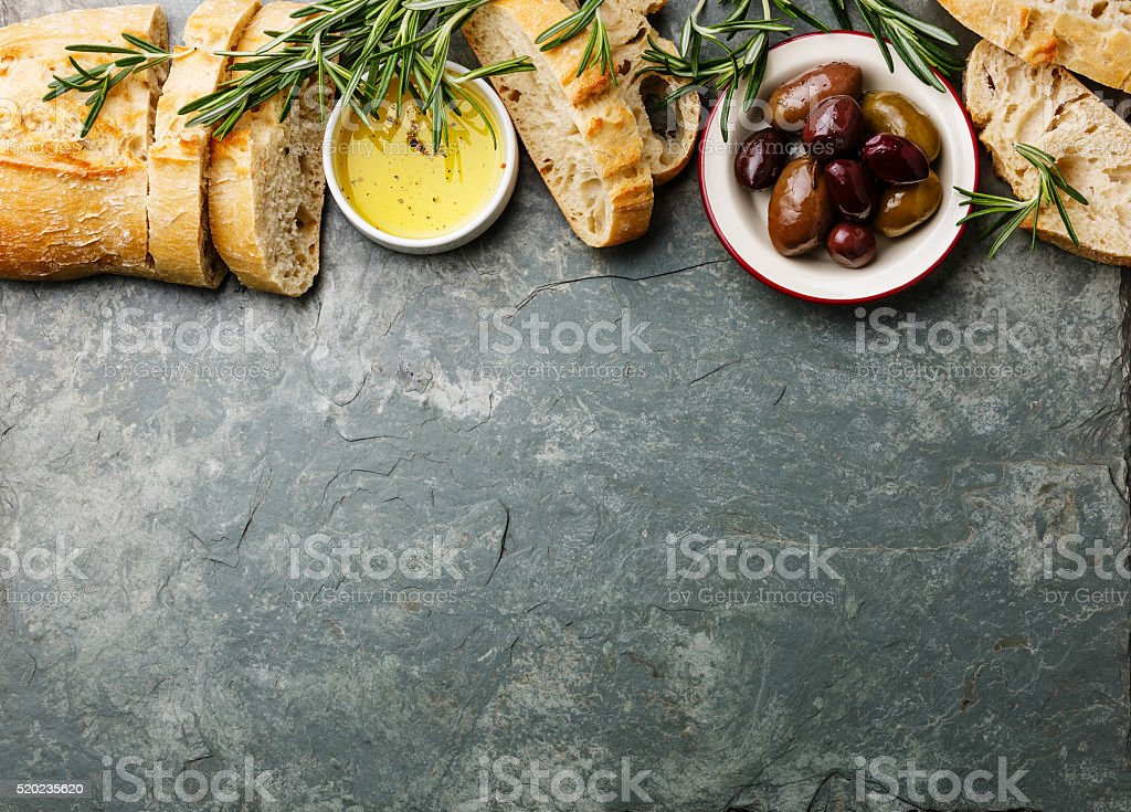 Italian food ingredients background with Ciabatta, oil, olives and rosemary stock photo