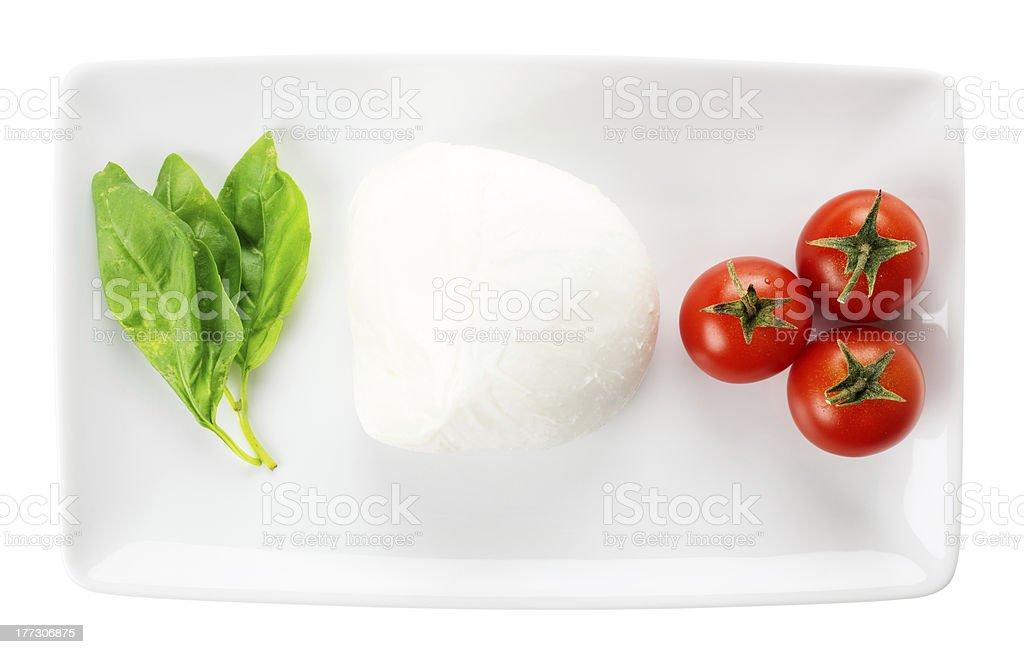 Italian food like flag, basil mozzarella tomato isolated on white royalty-free stock photo