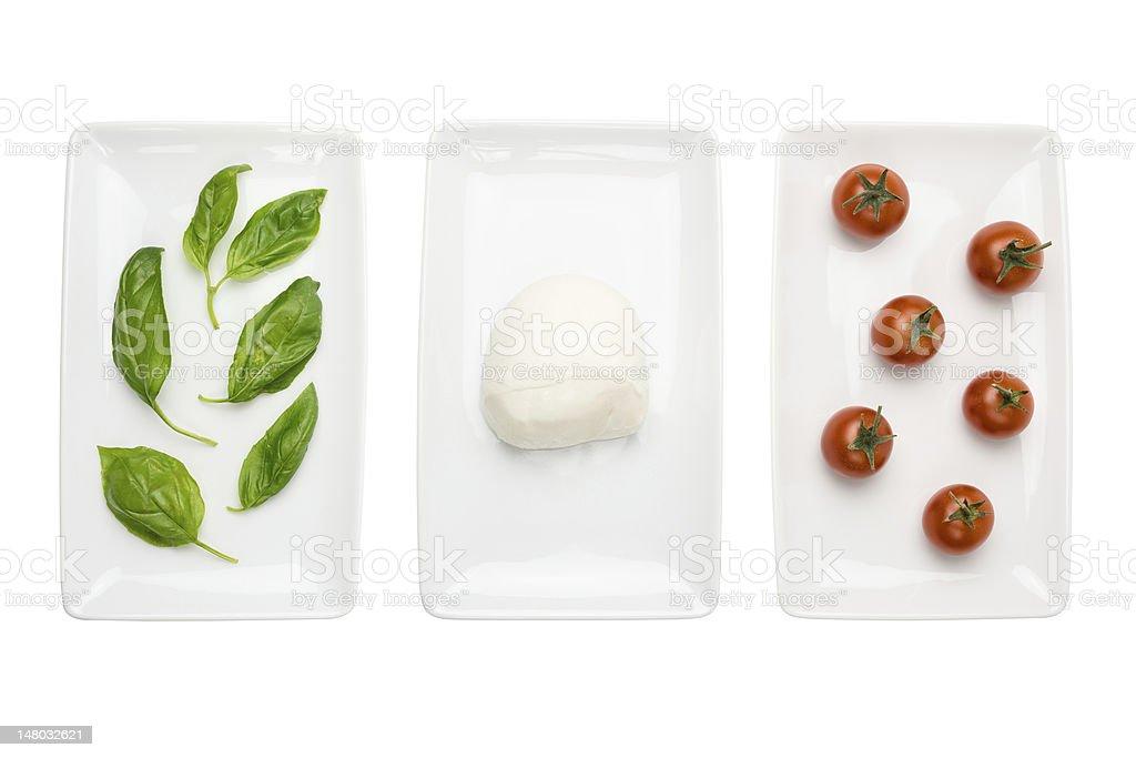 Italian food like flag, basil mozzarella tomato on white royalty-free stock photo