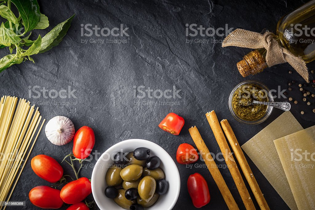 Italian food  mix on the black stone table top view stock photo