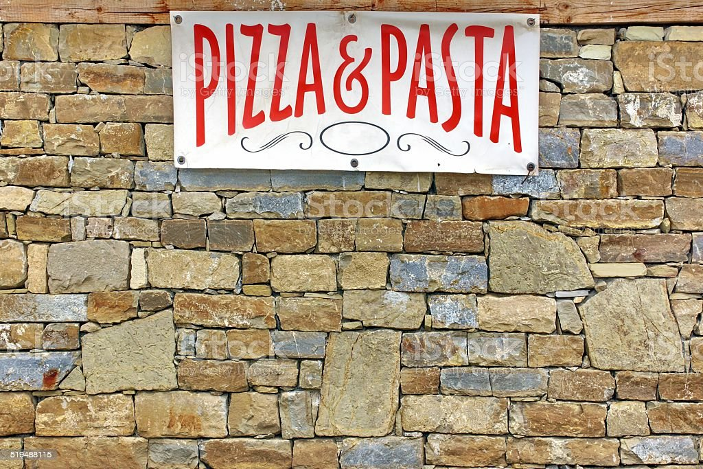 Italian Food Sign on Old Stone Wall stock photo