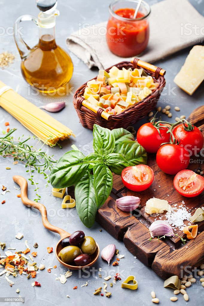 Italian food , tomatoes, basil, spaghetti, olives, parmesan. stock photo
