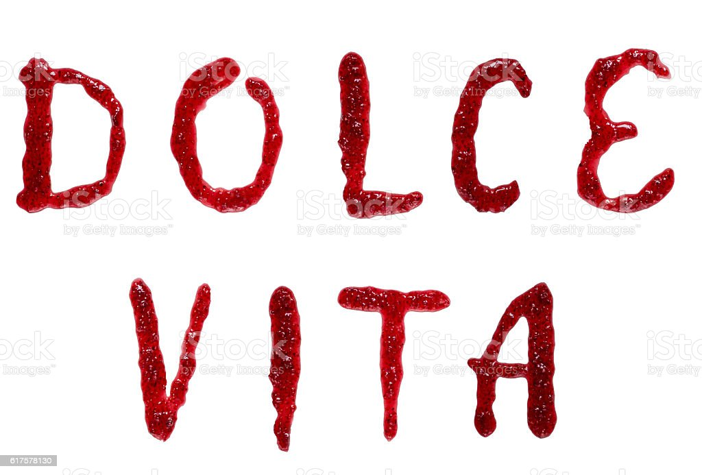 italian frase 'dolce vita' (sweet life) spelling with jam. stock photo