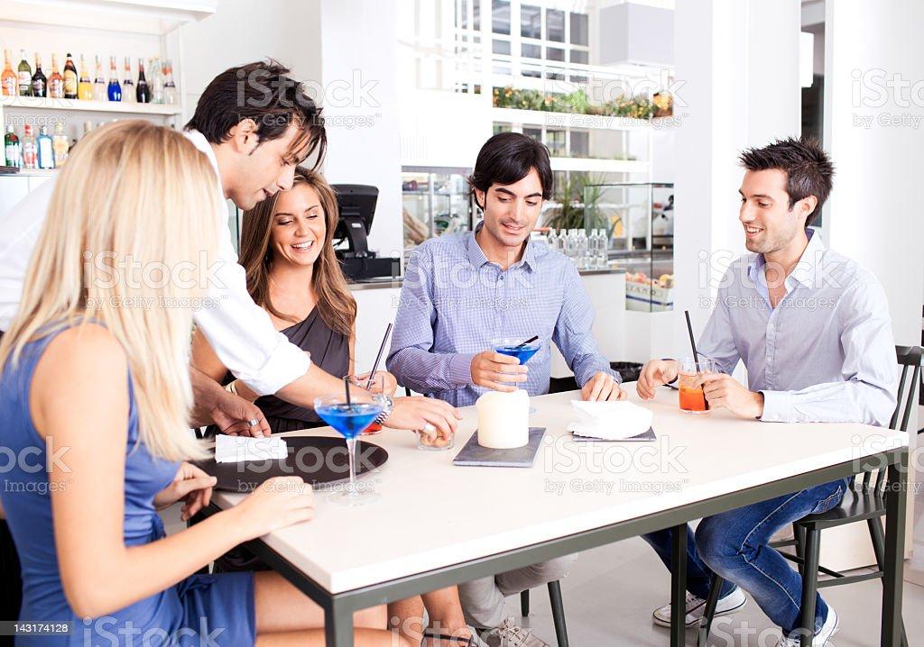 Italian friends in aperetivo bar royalty-free stock photo