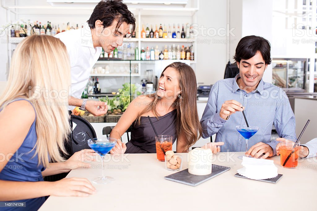 Italian friends in aperetivo bar royalty-free stock photo