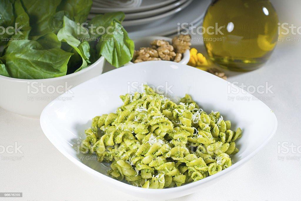 italian fusilli pasta and pesto stock photo