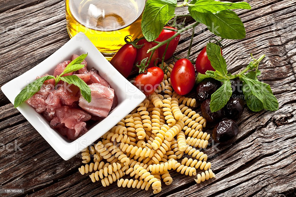 Italian Fusilli pasta with swordfish ingredients royalty-free stock photo