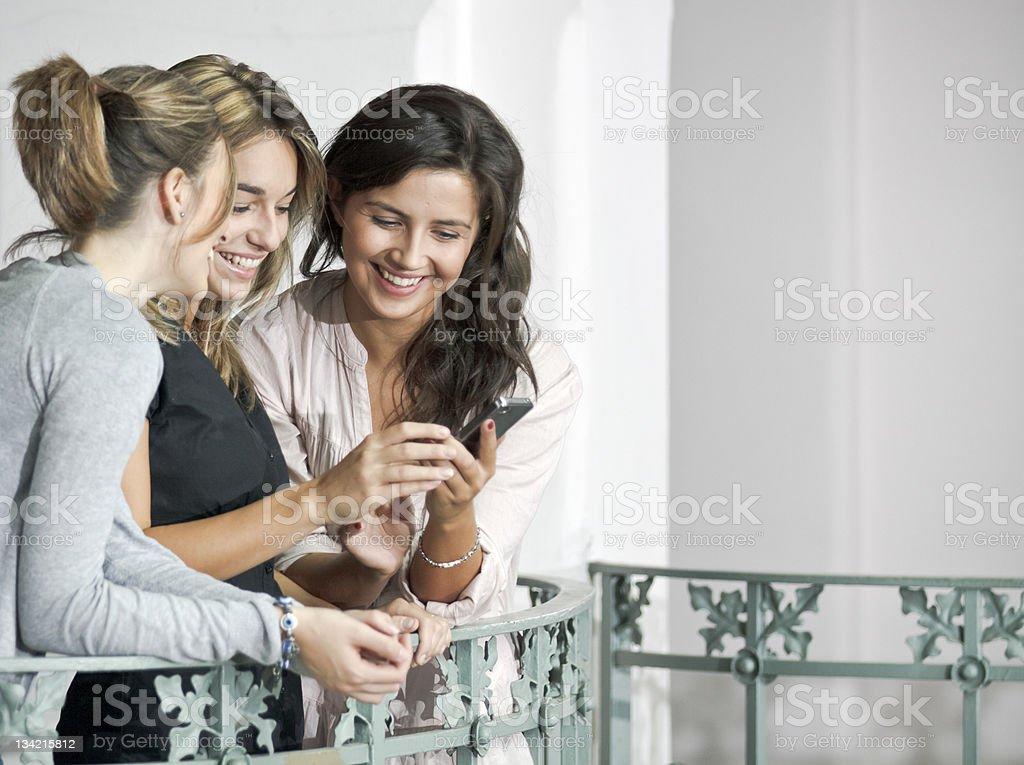 Italian Girls with mobile phone stock photo