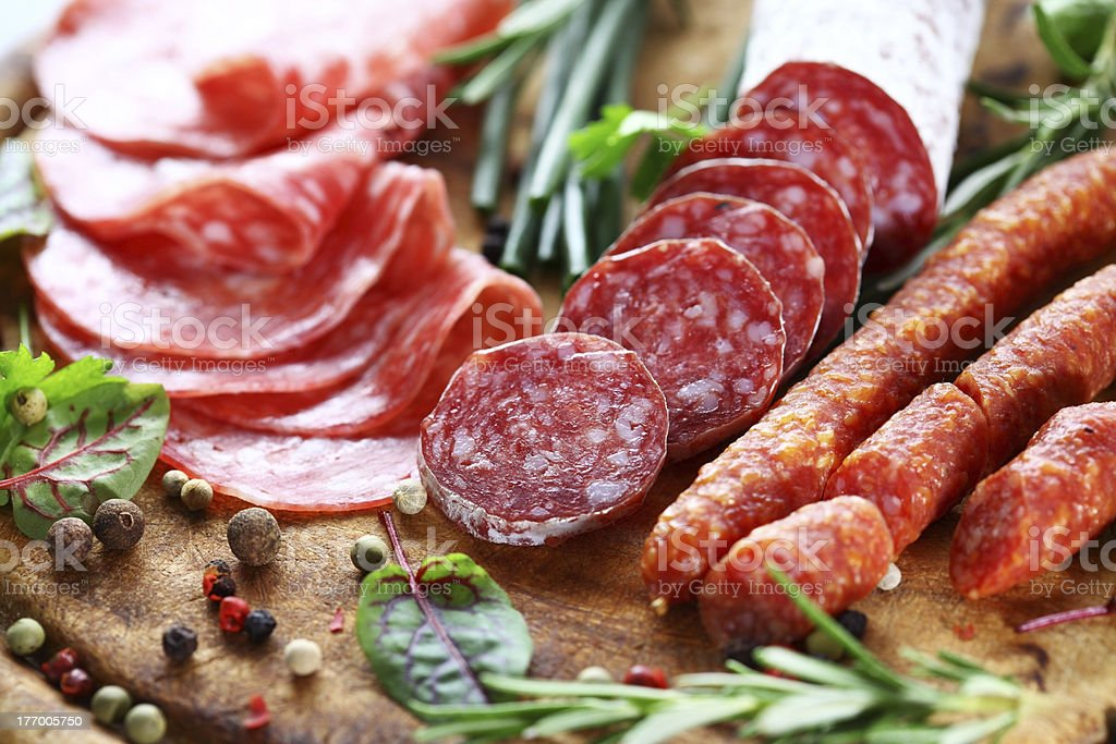 Italian ham and salami with herbs stock photo