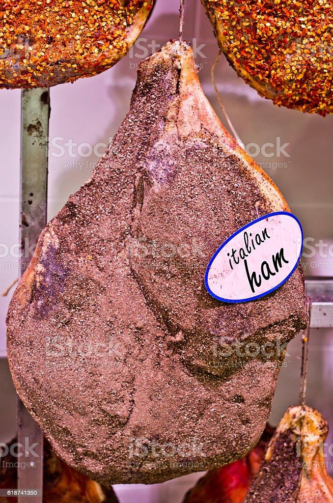 italian ham on the bone and spices, salt, pepper stock photo