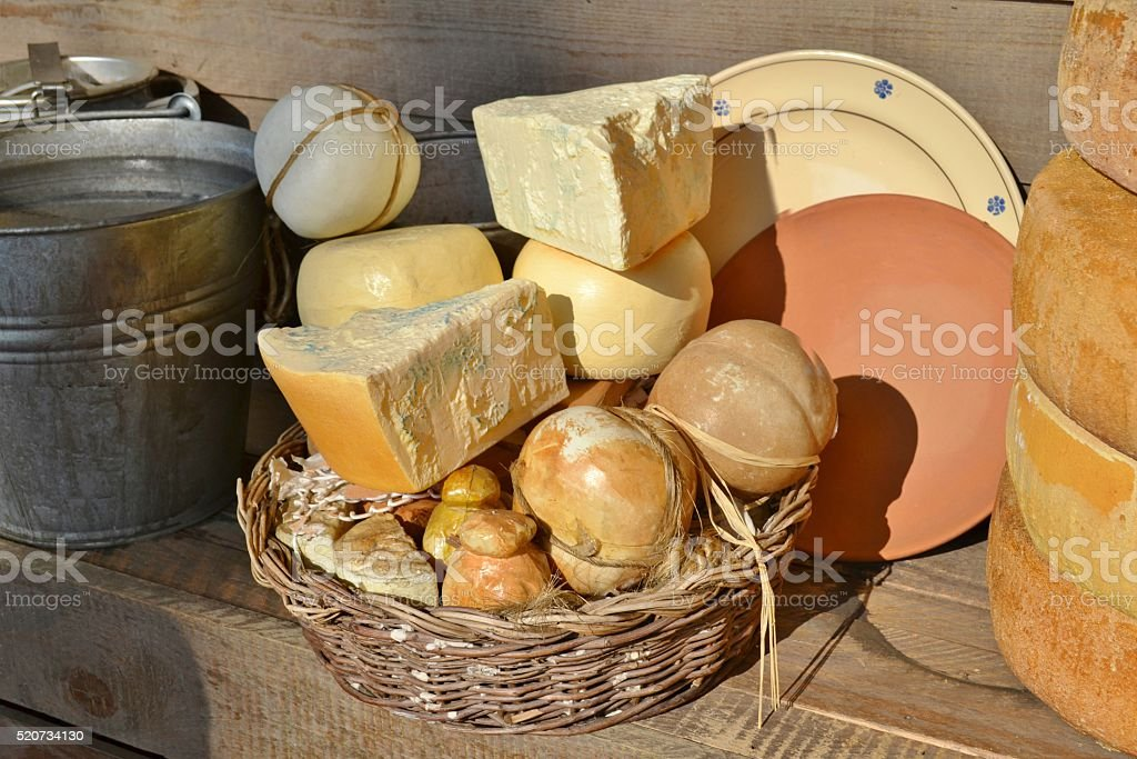 Italian hard cheeses, dishes and bucket filled with water. stock photo