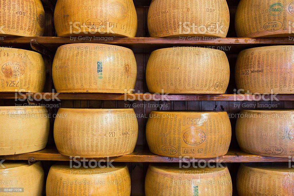 Italian hard Parmesan cheese on the shelves stock photo