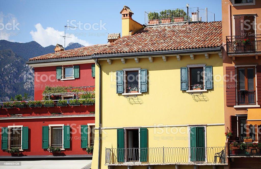 italian houses with window shutters in Malcesine,Lake Garda stock photo