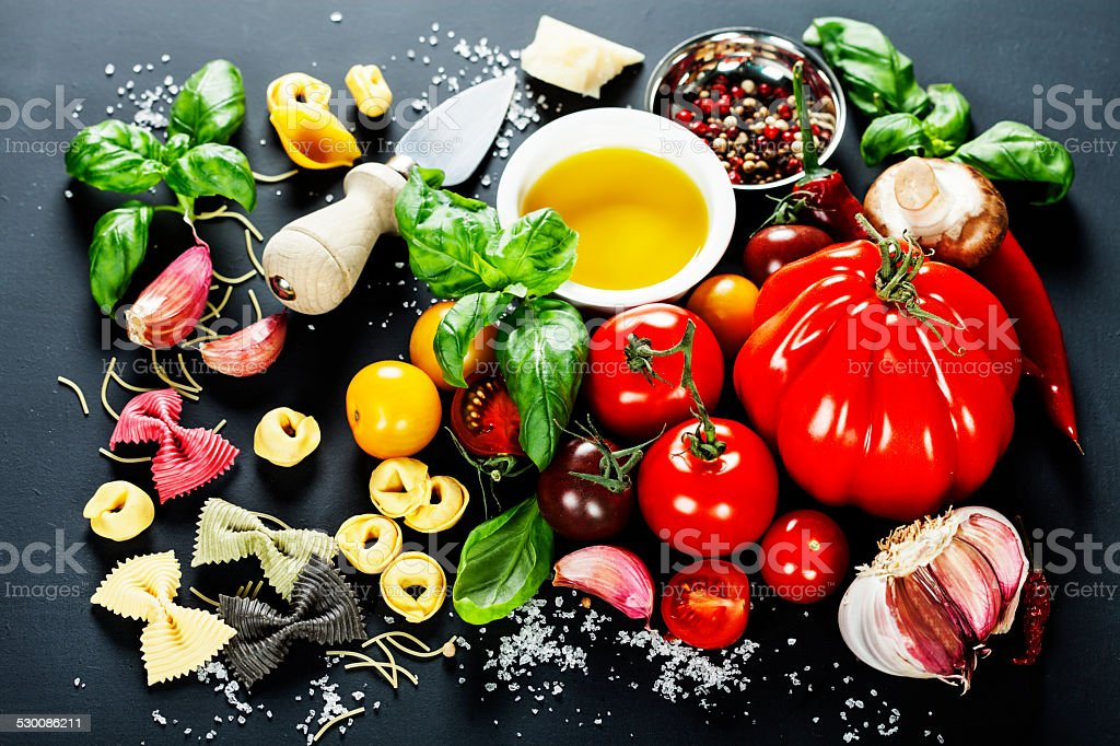 Italian ingredients - pasta, vegetables, spices, cheese stock photo