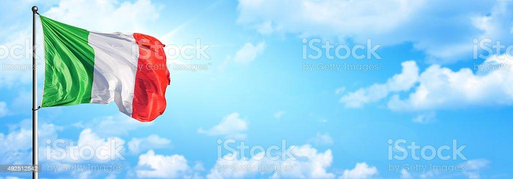 Italian - Italy flag with sky stock photo