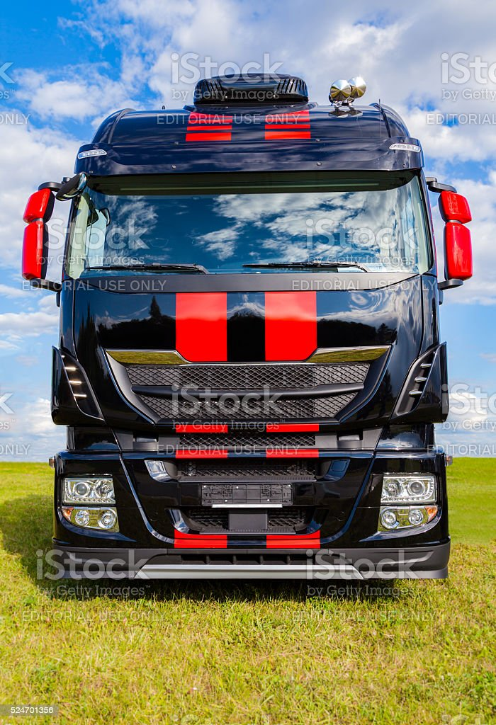 italian iveco truck stands on grass stock photo