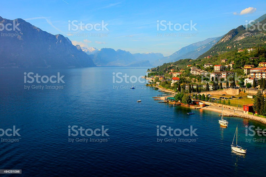 Italian Lake Garda paradise panorama sunset: landscape, Yacht ships, Malcesine stock photo