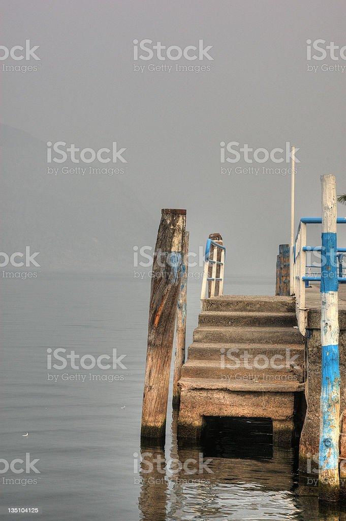 Italian lakeside wooden steps stock photo